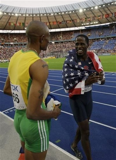 Godfrey Khotso Mokoena of South Africa gold medalist Dwight Phillips 2