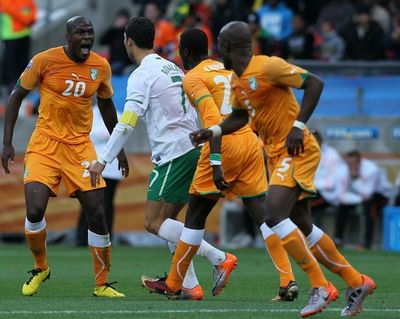 IV Portugal Cristiano Ronaldo argues with Ivory Coast's defender Guy Demel 3